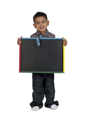 medium length: Smiling Asian boy holding slateboard against white background,