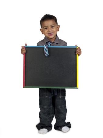slateboard: Smiling Asian boy holding slateboard against white background,