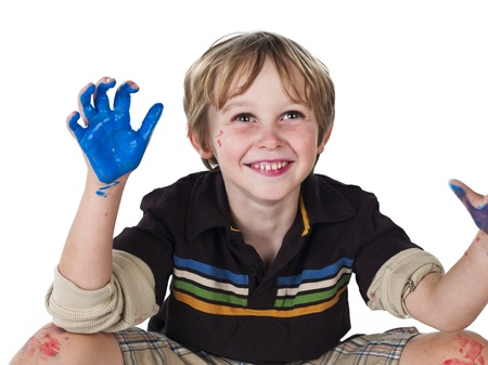 Smiling boy with paint on his hands over white background, photo