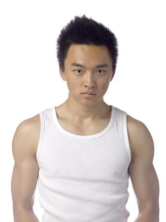athletic wear: Teenage asian guy wearing a white sleeveless shirt