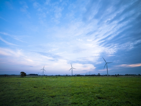 View of wind turbines in a field with clear sky in the background. Stock Photo - 17135296