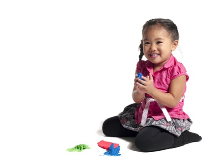 Portrait of cute little girl plays with a color paint Stock Photo - 17141483