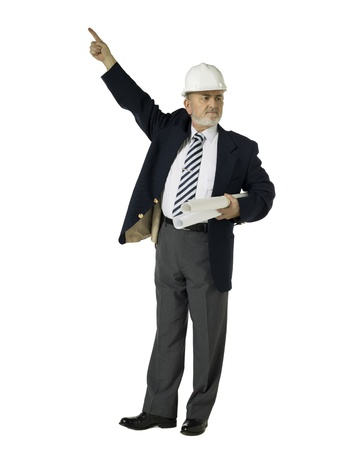 Portrait of an old architect wearing hat and holding blue prints pointing up against the white background photo