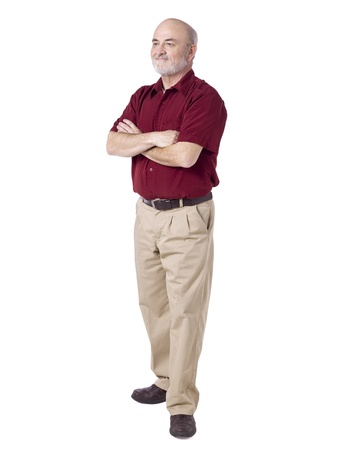 old man standing: Smiling old man standing with arm crossed on a white background