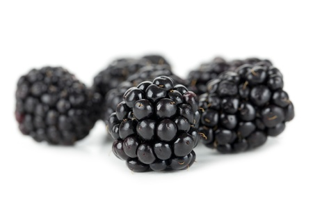 Closed up shot of fresh blackberries isolated in a white background