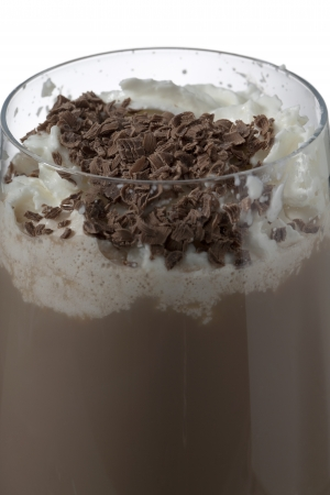 Close-up image of chocolate drink with whipped cream over the white background