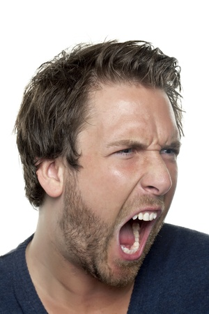 Close up image of angry man yelling against white background