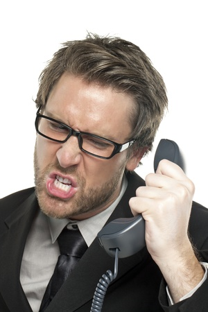 Portrait of a stressed businessman answering call over the white background Stock Photo - 17148567