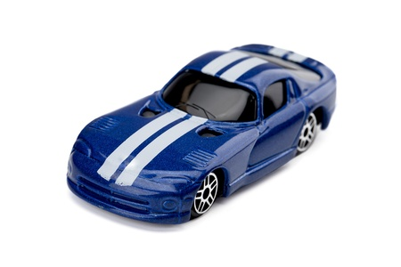 Close-up image of a blue toy sportscar against the white surface Stock Photo - 17141495