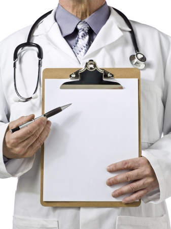 Cropped image of a doctor with the camera focused on the clipboard photo