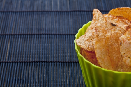 Cropped bowl of spicy flavored potato chips Stock Photo