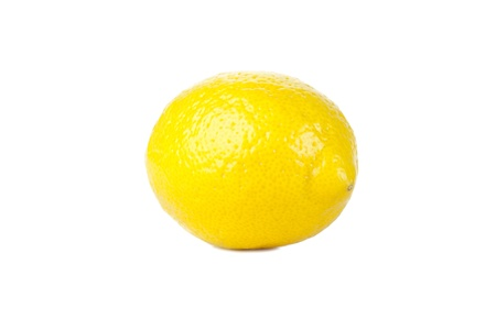 sourness: Close-up image of fresh and juicy lemon against the white surface