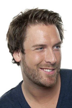 Side view image of man smiling and looking to the side of a white background photo