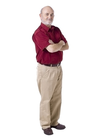 one mature man only: Portrait of old man standing while in cross arms against white background Stock Photo
