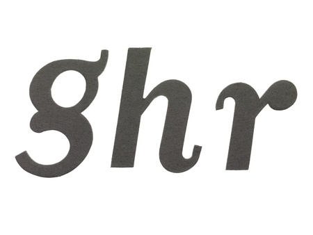 cut paper: Close-up image of a paper cut out with letters ghr