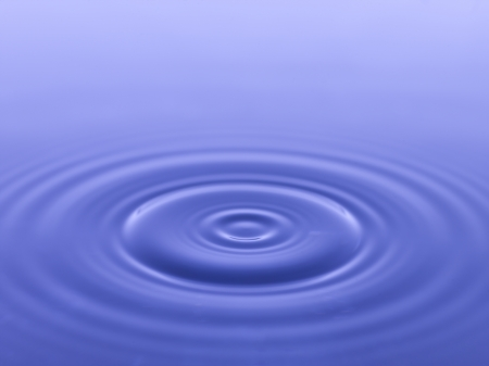 ripple effect: Close up image of ripple on blue water