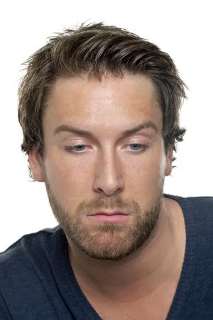 sad face: Closeup portrait of a man with sad face looking down