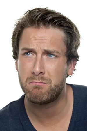 Close up image of sad man face against white background photo