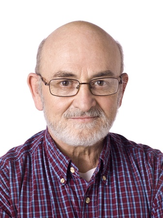 Portrait of smiling old man wearing eye glasses against white background
