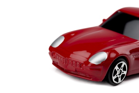 Cropped image of a tinted red toy car over the white surface Stock Photo - 17141423