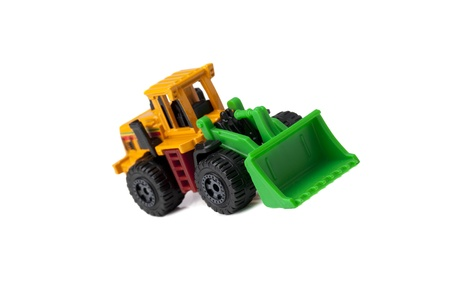 sand quarry: Isolated image of toy bulldozer over a white background