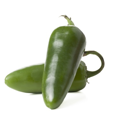 Closed up shot of two jalepeno peppers lying on a white background Standard-Bild