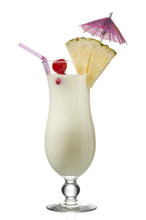 d: Close-up shot of pineapple milkshake decorated with pineapple slice, umbrella and drinking straw.