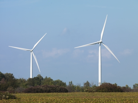 View of modern wind turbines in field with blue sky in the background. Stock Photo - 17148452