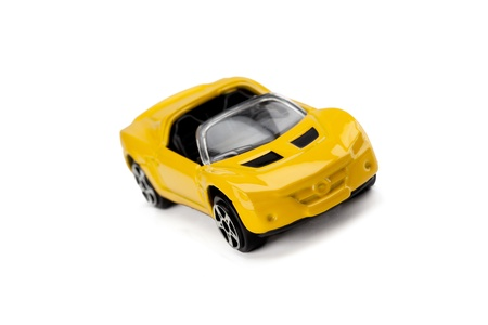 top down car: Image of yellow top down toy car isolated on a white surface