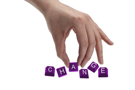 Concept shot of hand holding keyboard keys and spelling the word change. photo