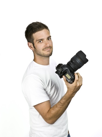 Smiling male photographer displaying his camera. Stock Photo - 17396252