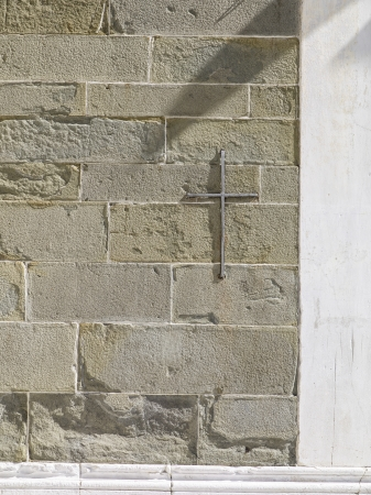split level: A vertical image of a modern stone brick wall with a sign of cross