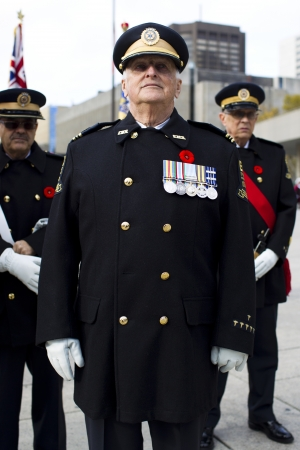 military uniform: Senior people in military uniform on remembrance day.