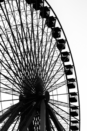 amusement park black and white: Low angle silhouette image of ferris wheel at amusement park.