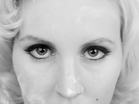 Black and white close-up image of a woman with flour on her faceMUA and Model: Amanda Wynne www.awynnemakeup.com Stock Photo - 17143871