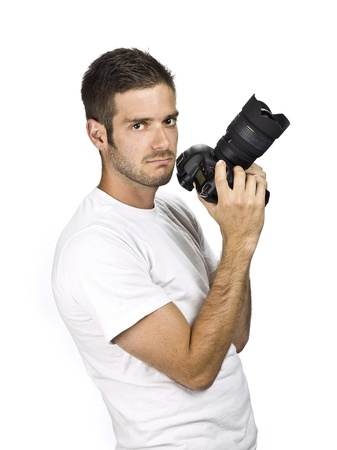 Male model holding camera at an angle. photo