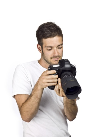 Guy reviewing picture he took through camera LCD. photo