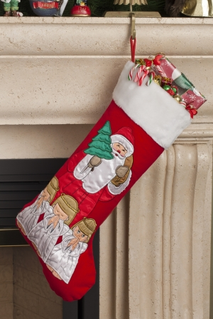 Portrait christmas socks with gifts on a chimney Stock Photo - 17149846