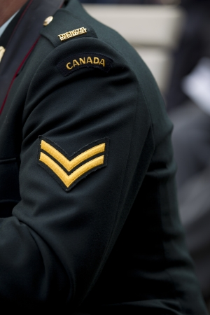 military uniform: Detailed close-up shot of shoulder of a man in  military uniform. Stock Photo