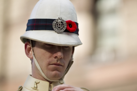Close-up shot of soldier with headwear.