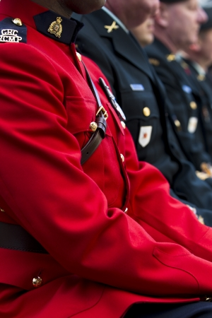 Cropped close-up view of a man in red uniform. photo