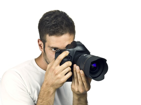 Young man taking photograph with SLR camera. photo