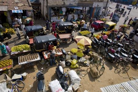 A traffic jam of street vendors and rickshaws in Mysore, India. Stock Photo - 17146564