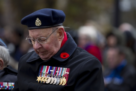 military uniform: Close-up shot of a senior citizen in military uniform and medal.