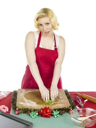 Woman preparing pastry for christmas against white background, MUA and Model: Amanda Wynne www.awynnemakeup.com Stock Photo - 17287287