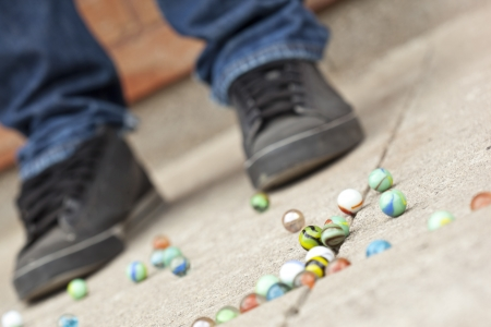 Image of assorted colorful marbles on ground photo