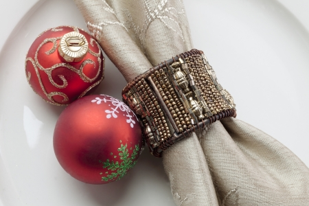 Close-up shot of Christmas bauble with napkin on plate photo