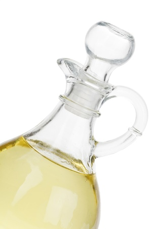 Cropped image of glass bottle with vegetable oil isolated on a white background Banco de Imagens