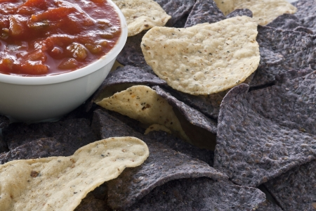 Close up image of bowl of salsa dip with blue nachos and tortilla chips Stock Photo - 17149876