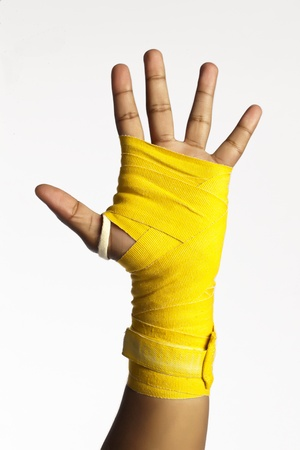 body expression: Close-up image of boxers palm with a bandage isolated on a white background